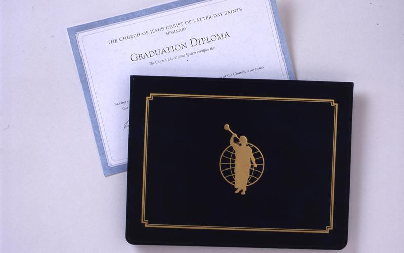 Seminary graduation diploma and cover