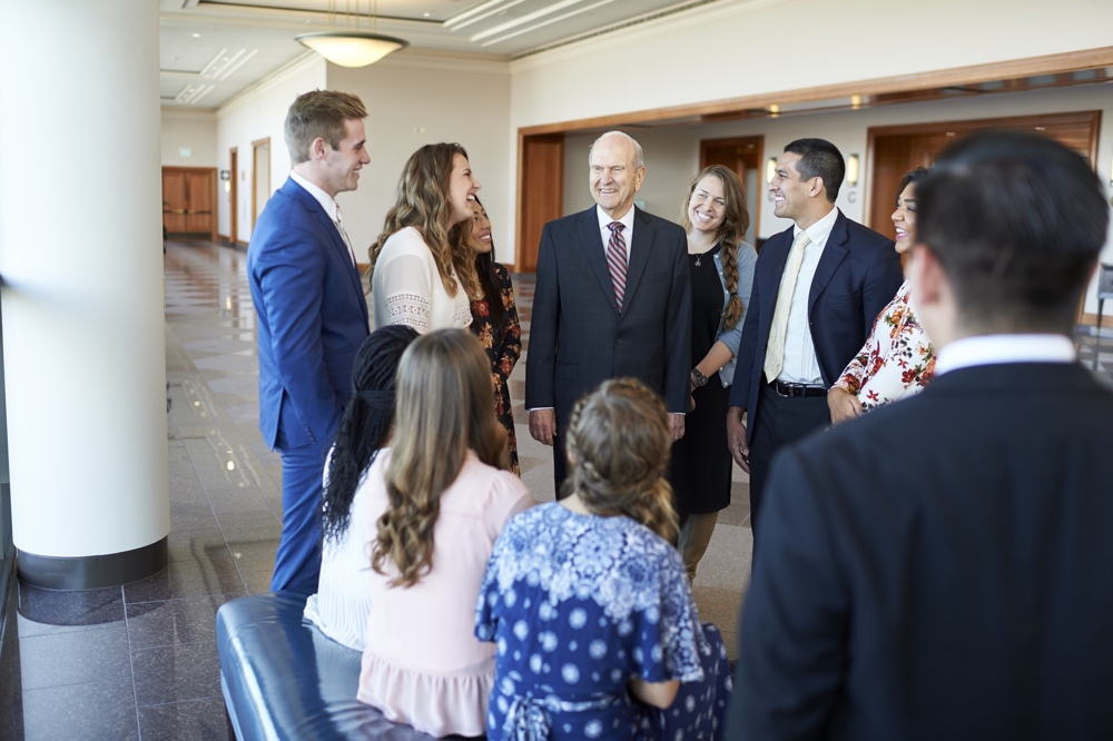 President Russell M. Nelson with young adults