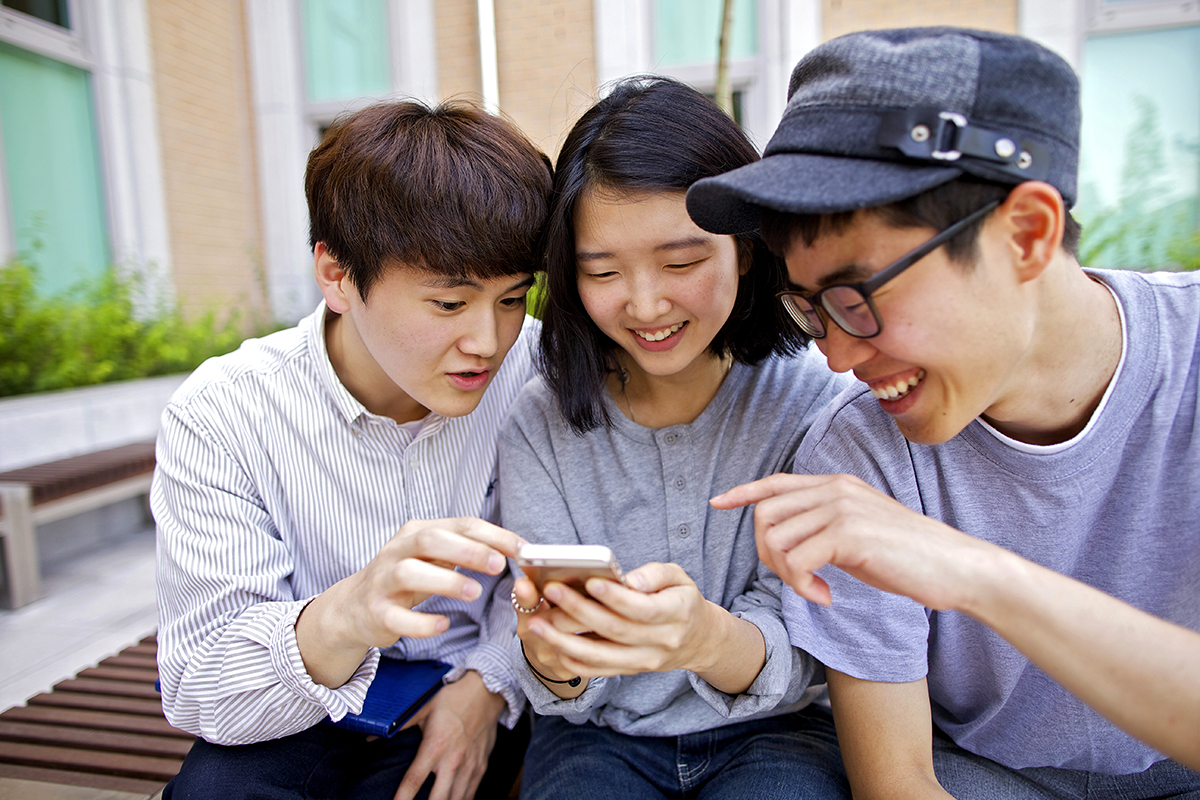 youth looking at phone