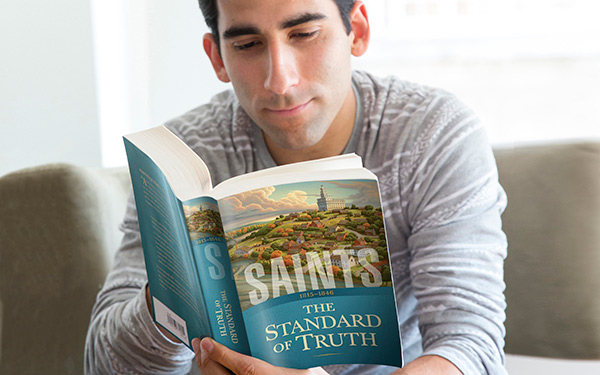 Man reading Saints
