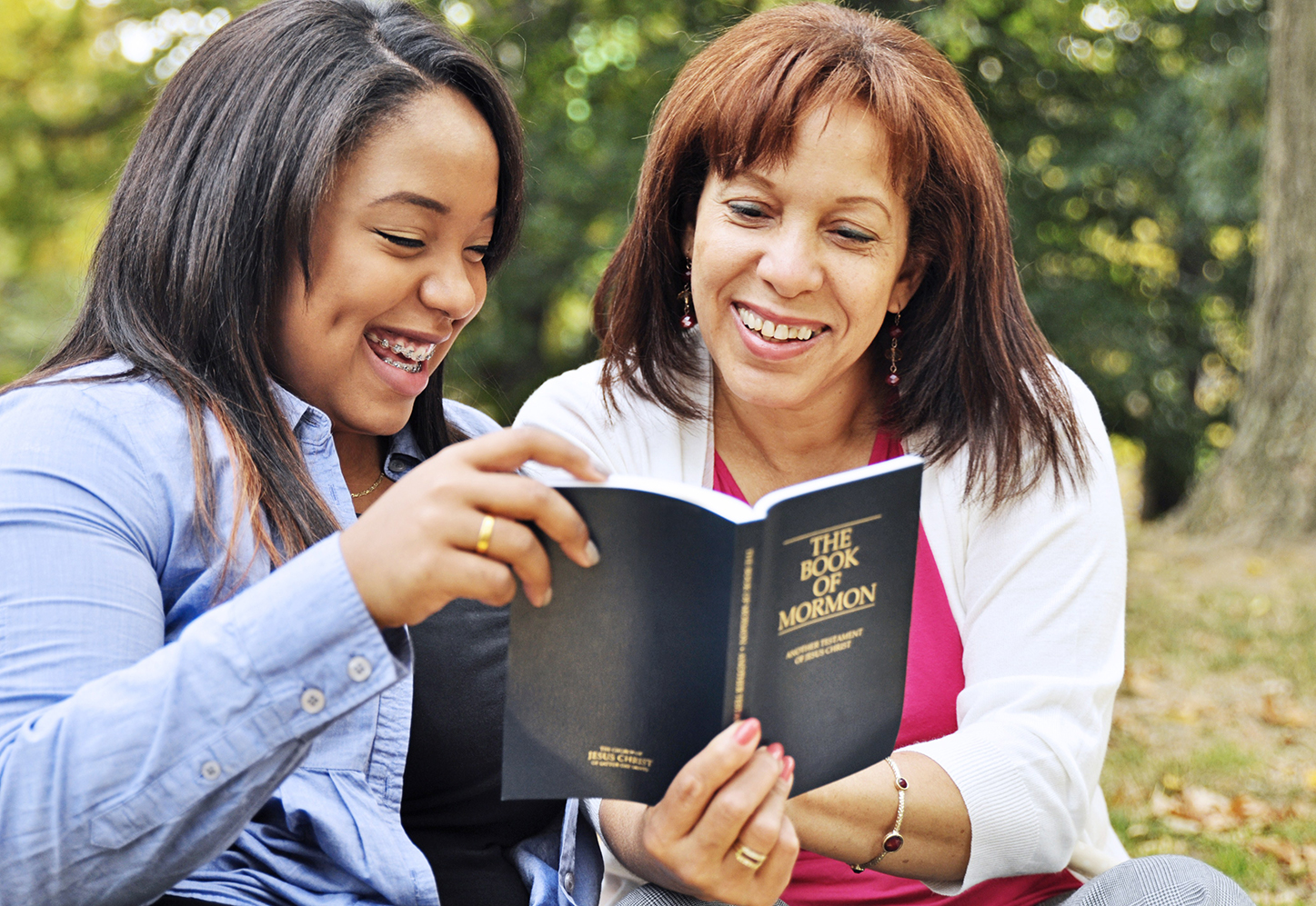Mother reading scriptures with daughter