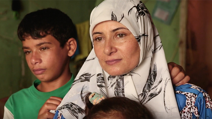 A refugee mother with her son and daughter.