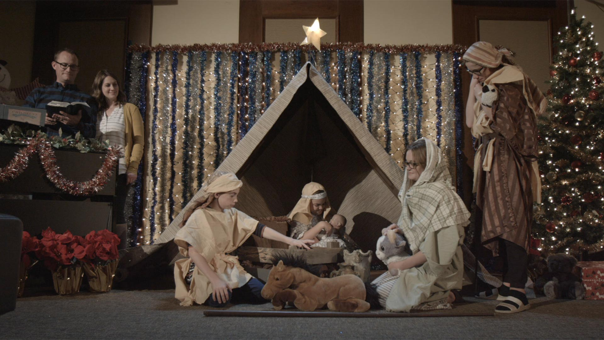 A family performing a Nativity scene.