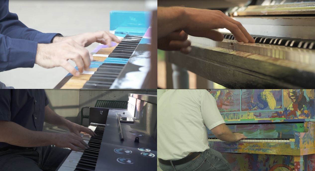 Four job coaches play a quartet on the piano.